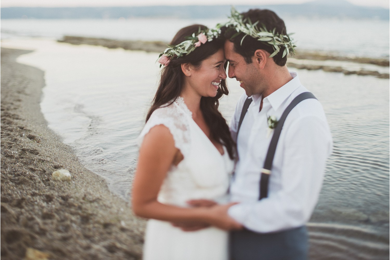 newlyweds at beach wedding ceremony in Crete