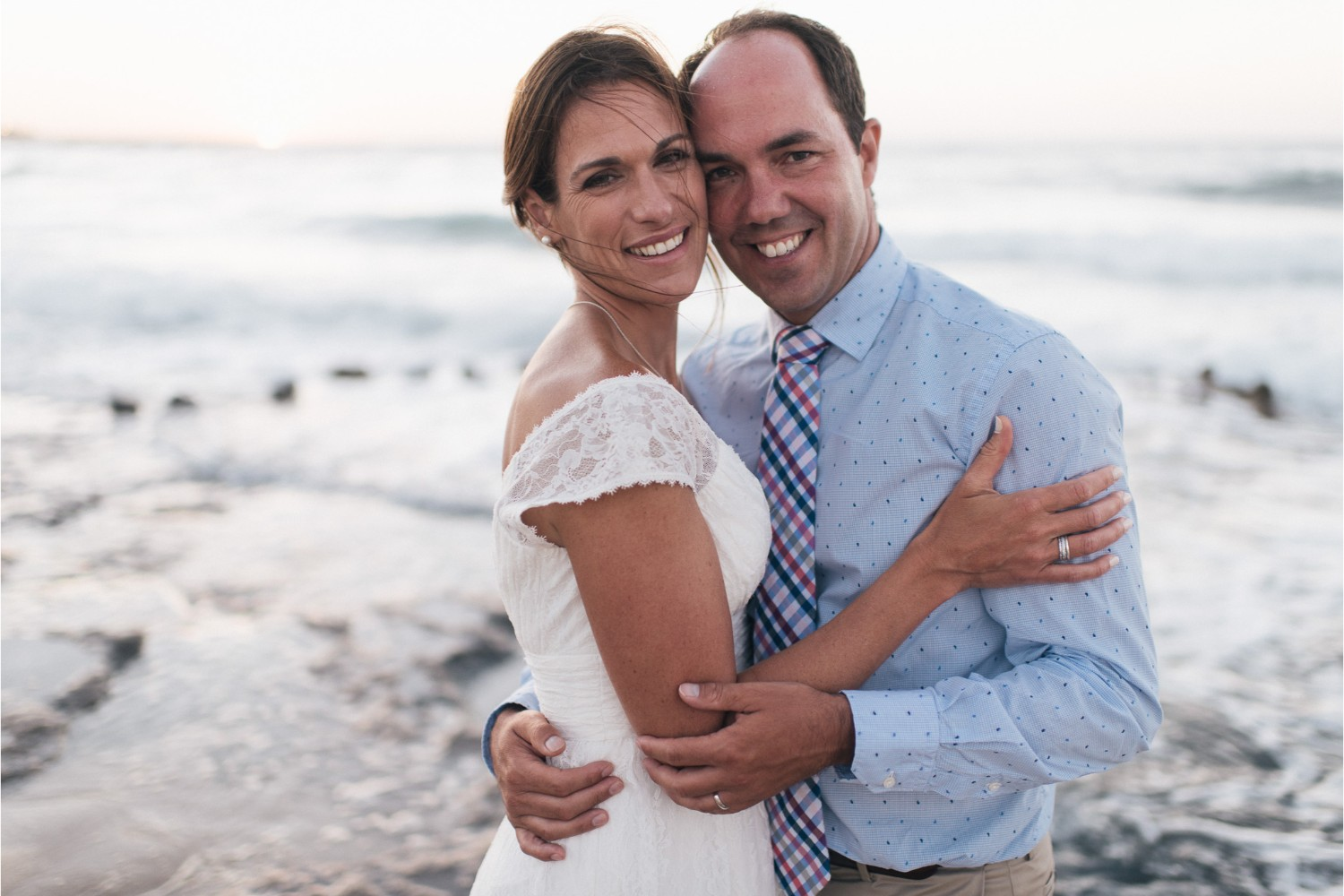 wife & husband at vow renewal on the beach in Crete