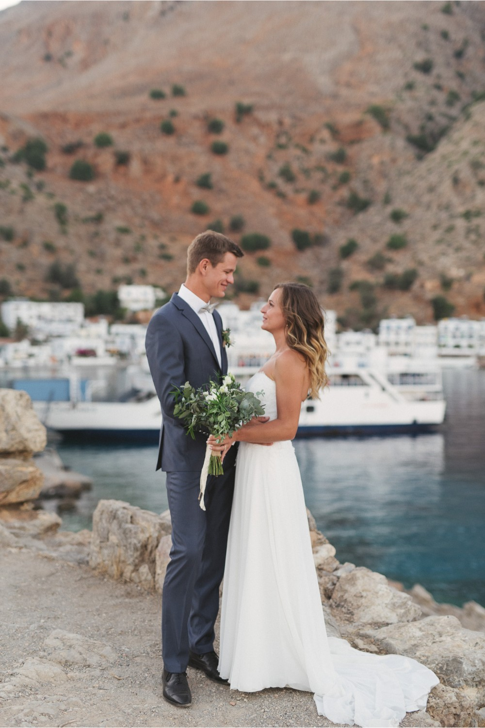 newlyweds at seaside wedding in Crete