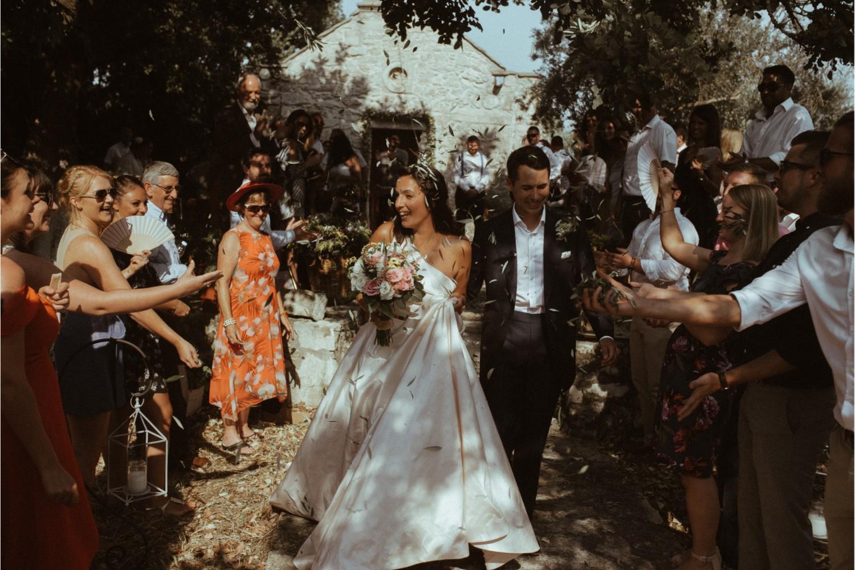 olive leaves confetti moment at villa wedding in Crete