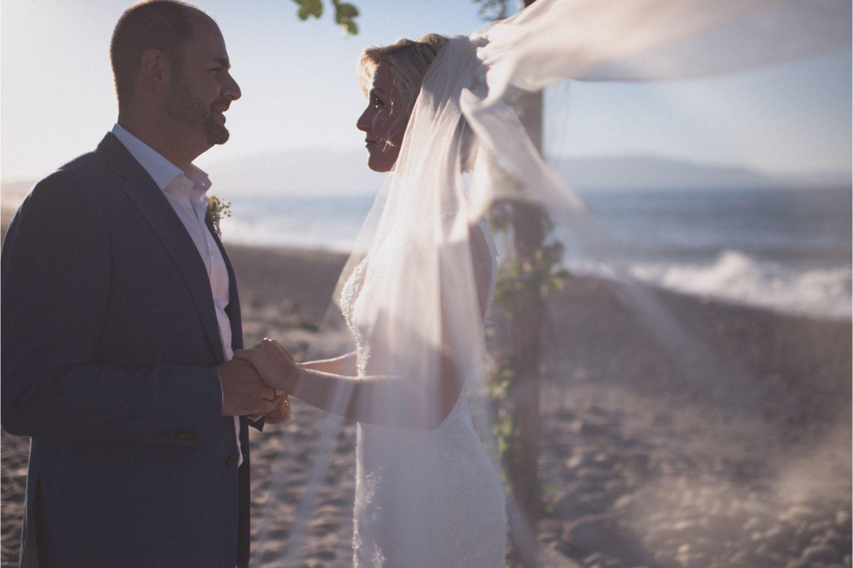 bride & groom at seaside wedding ceremony in Crete