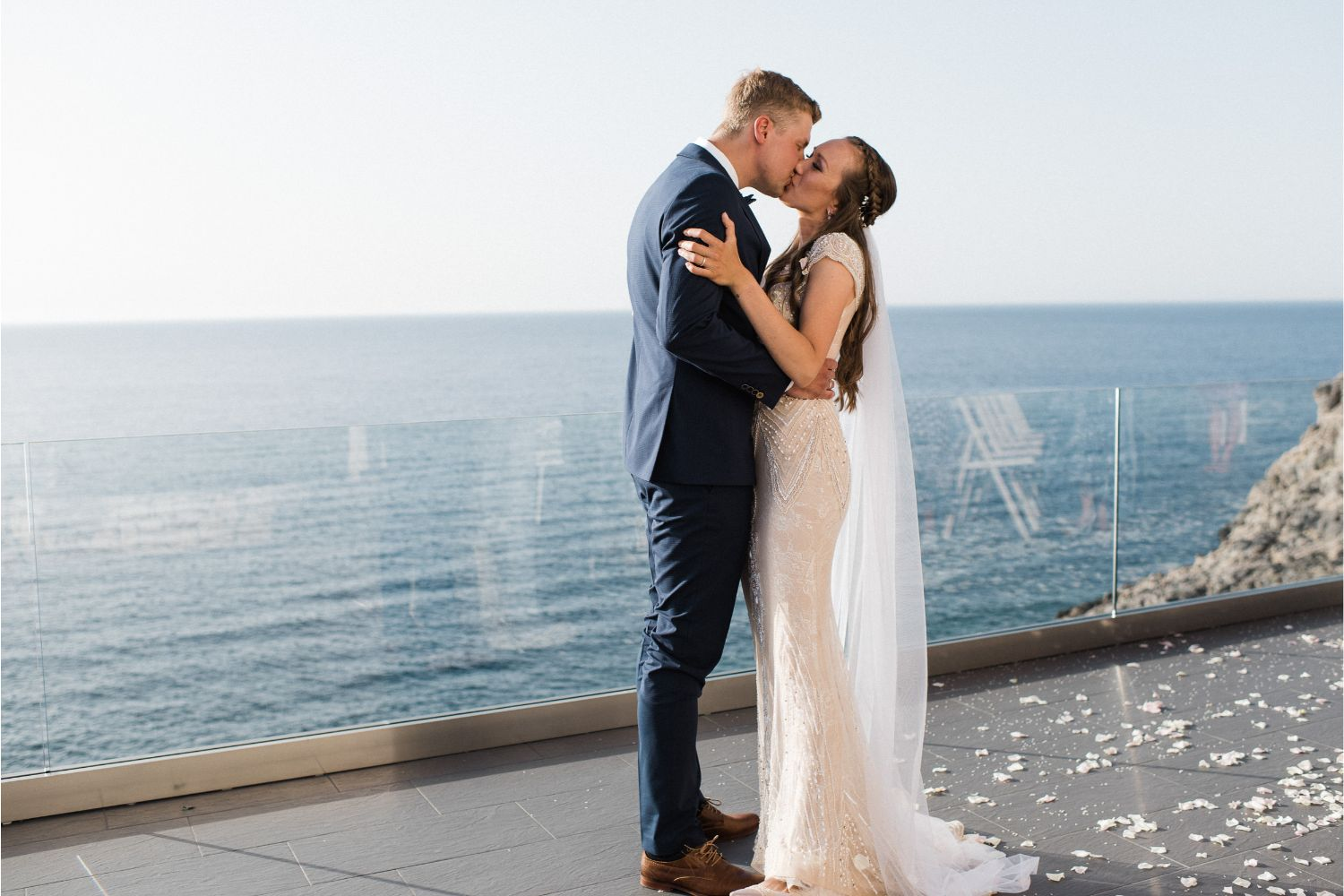 newlyweds kiss at private seaview villa