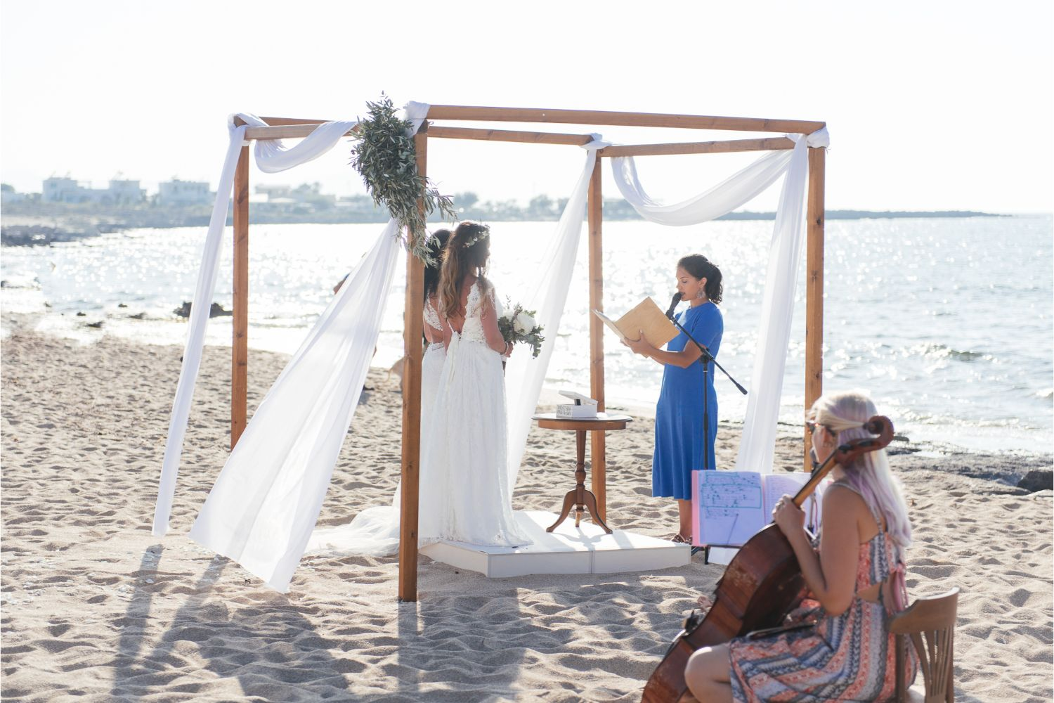 same-sex wedding ceremony on the beach