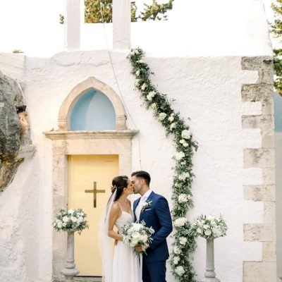 newlyweds at Greek Orthodox wedding ceremony in Crete