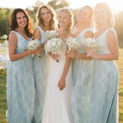 bride & bridesmaids at seaside villa wedding ceremony in Crete