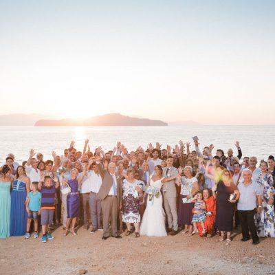 newlyweds & guests at church wedding ceremony in Crete