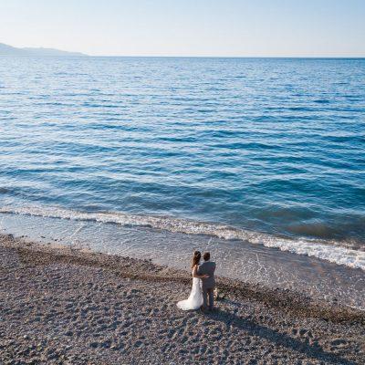 newlyweds portrait session at beach wedding in Crete