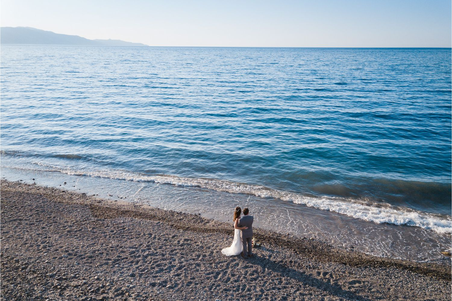 newlyweds portrait session at beach wedding in Crete