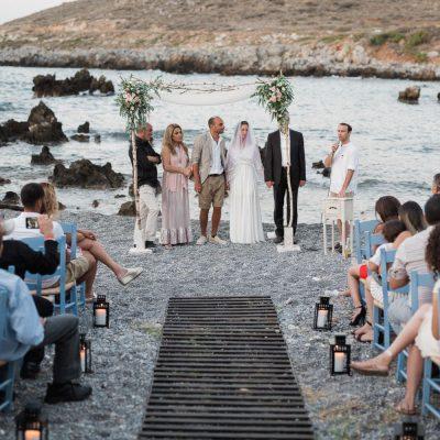 chuppah ceremony at seaside villa wedding in Crete