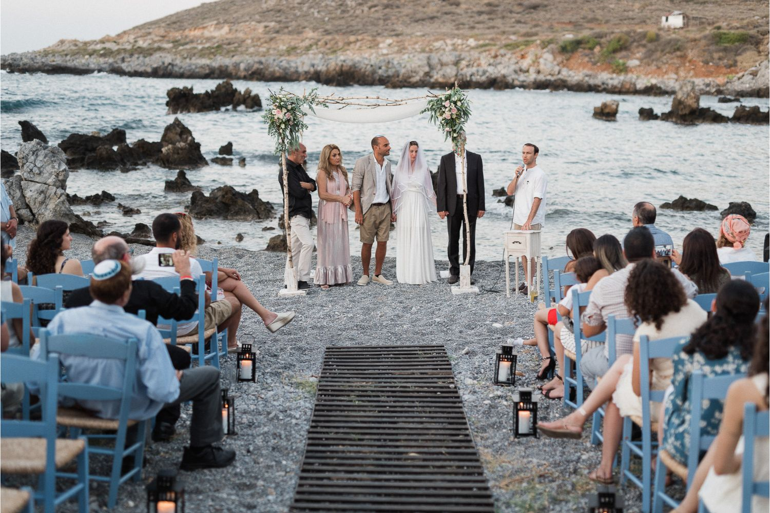chuppah ceremony at seaside villa wedding in Crete