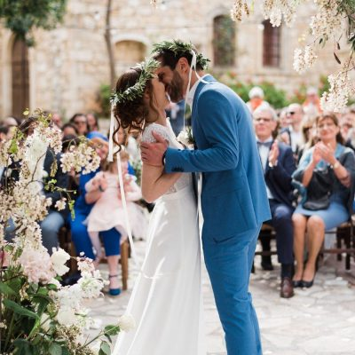 bride & groom first kiss at rustic wedding in Crete