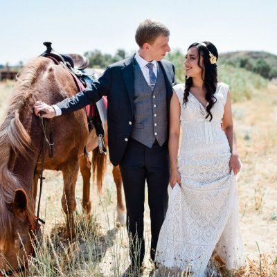 bride & groom photo session with horses before church wedding in Crete