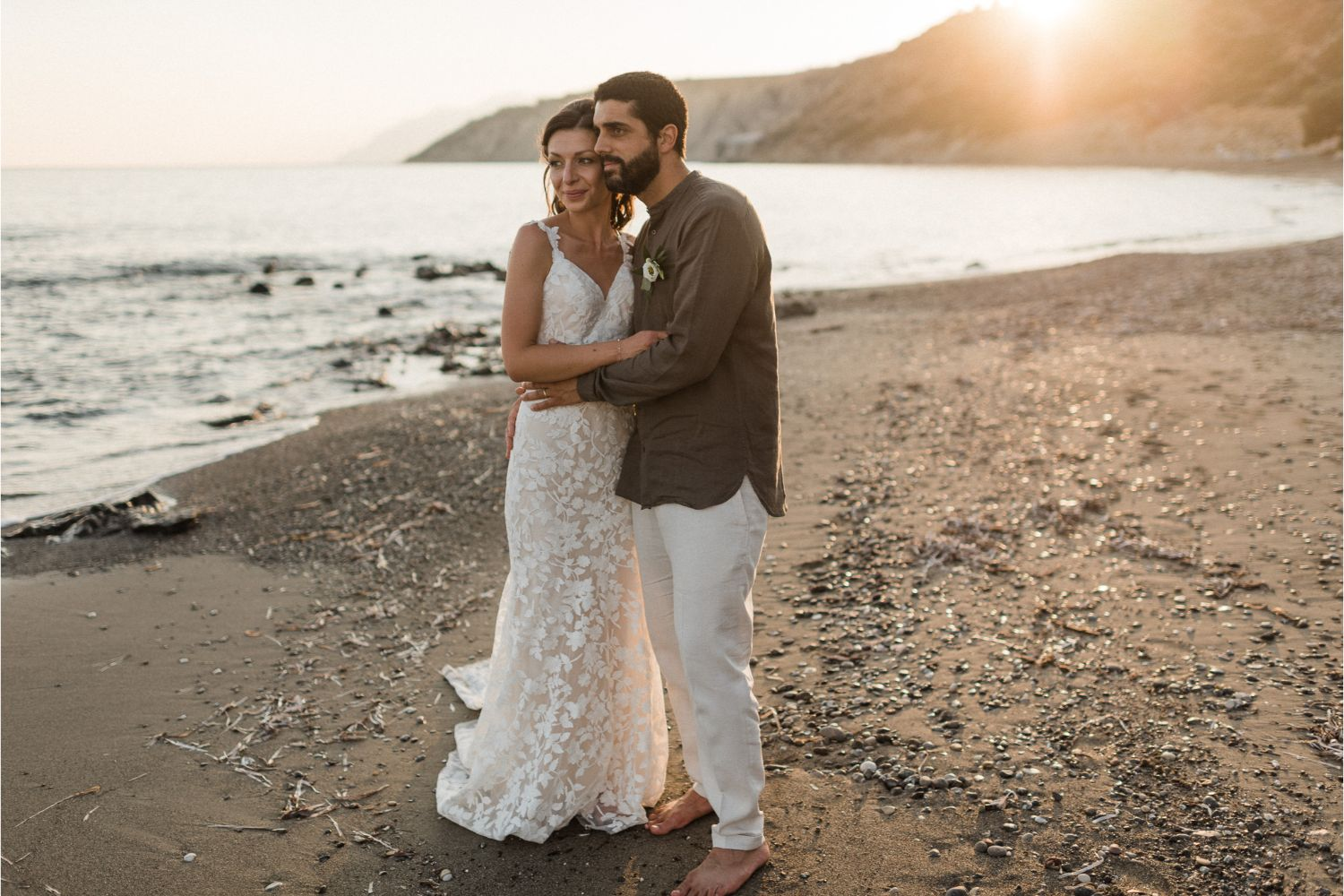newlyweds photoshoot after beach wedding ceremony in Crete