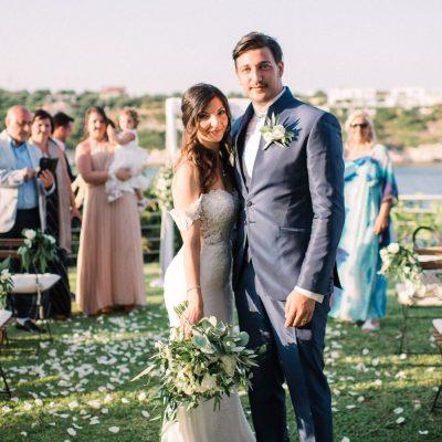 newlyweds at seaside wedding ceremony in Crete
