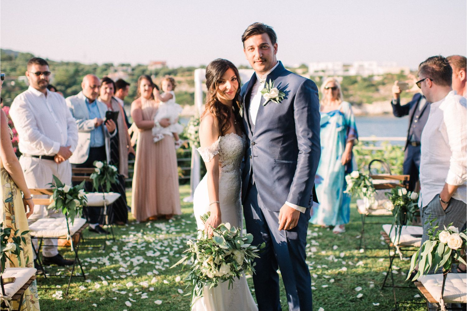 newlyweds at seaside wedding ceremony in Crete