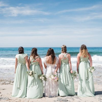 bride & bridesmaids at beach wedding in Crete