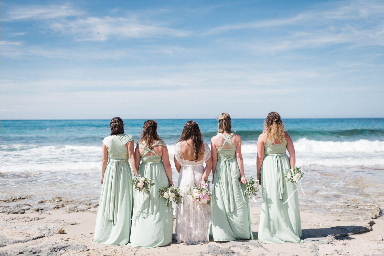 bride & bridesmaids at beach wedding in Crete