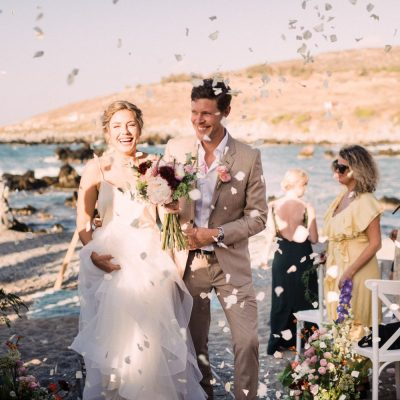 wedding recessional at seaside wedding ceremony in Crete