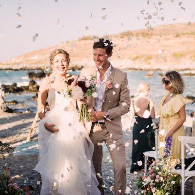 wedding recessional at seaside wedding ceremony in Crete