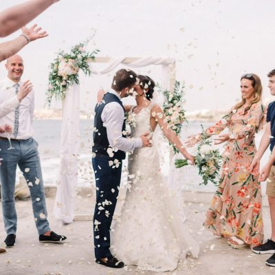confetti moment at seaside wedding ceremony in Crete