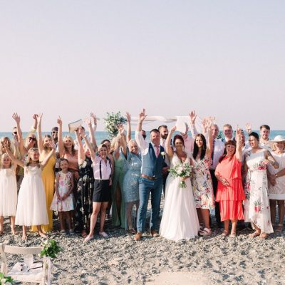 group photo at wedding ceremony on the beach in Crete