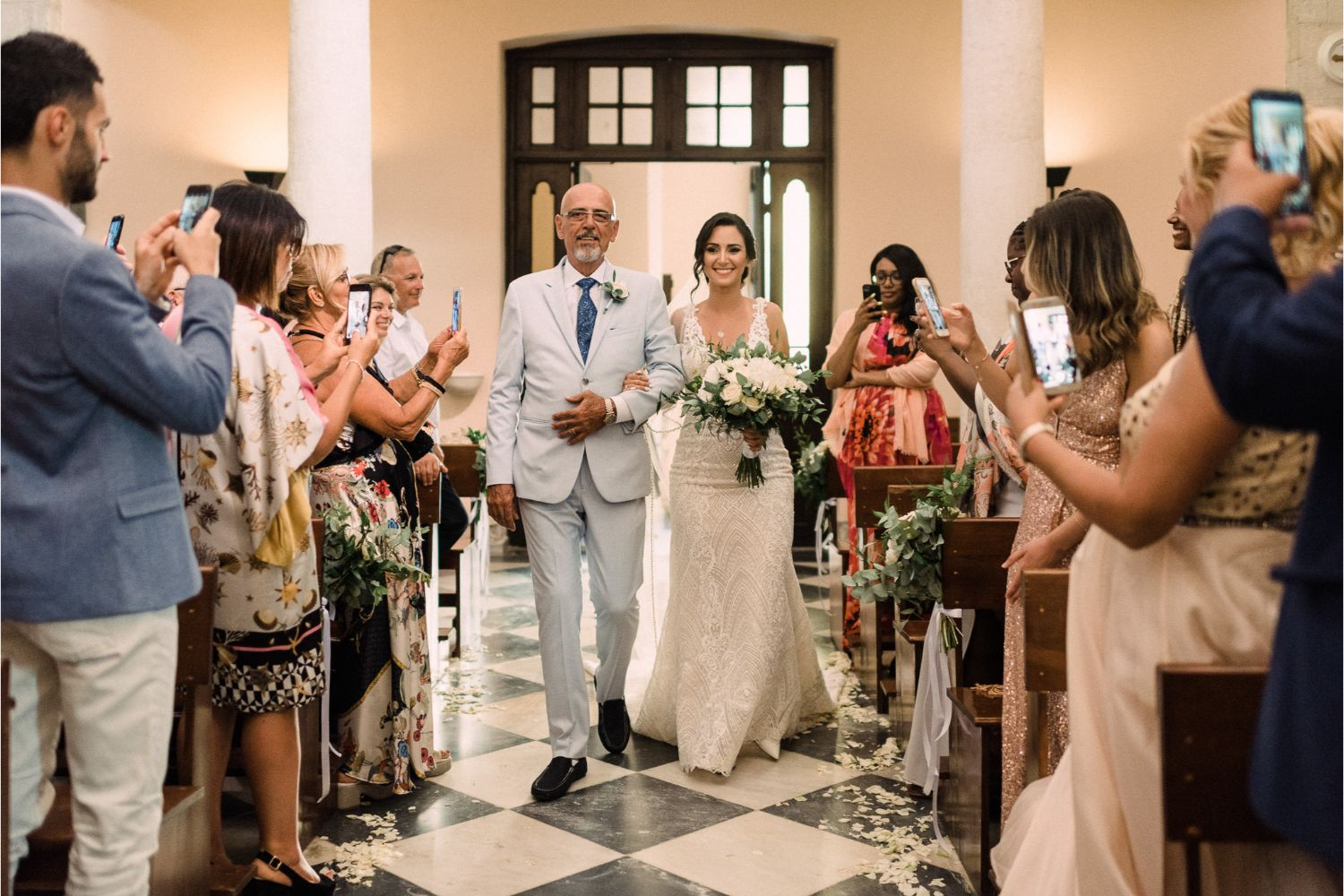 bride walking down the aisle at catholic church wedding in Crete