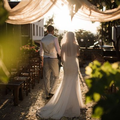 newlyweds walking up the aisle at winery wedding in Crete