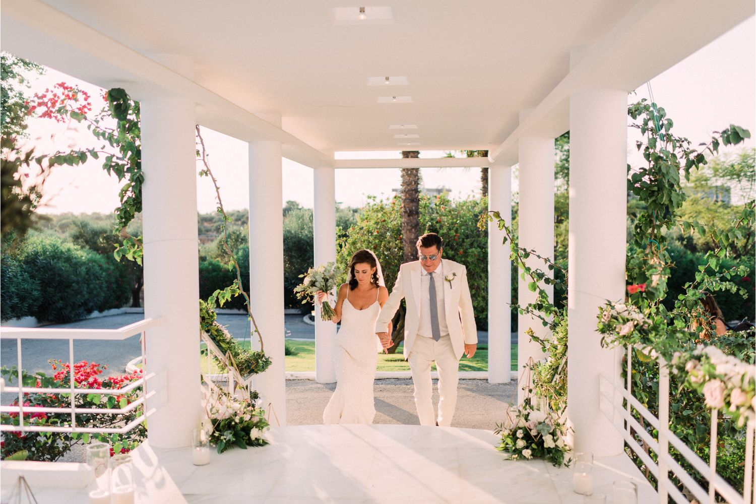 newlyweds entrance to villa wedding in Crete